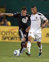 Chris Pontius #13 of D.C. United battles against Sean Franklin #28 of the Los Angeles Galaxy during an MLS match at RFK Stadium on July 18 2010, in Washington D.C.Galaxy won 2-1.