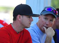 May 6, 2012; Commerce, GA, USA: NHRA top fuel dragster driver Steve Torrence (left) talks with Pat Dakin during the Southern Nationals at Atlanta Dragway. Mandatory Credit: Mark J. Rebilas-