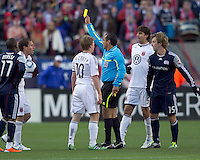Referee Baldomero Toledo issues yellow card to DC United midfielder Kurt Morsink (6) as DC United midfielder Dax McCarty (10) discusses the card. In a Major League Soccer (MLS) match, the New England Revolution defeated DC United, 2-1, at Gillette Stadium on March 26, 2011.