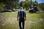 Gold miner James Butler walks on his mining claim in the Sierra foothills near Smartsville, California, April 19, 2012..CREDIT: Max Whittaker/Prime for The Wall Street Journal.MINER