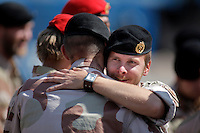 Soldiers embrace after the ceremony. Norwegian soldiers receive medals after a tour with International Security Assistance Force (ISAF), Afghanistan. Prime Minister Jens Stoltenberg and Defense Minister Grete Faremo attended the ceremony held at Akershus Castle in Oslo.