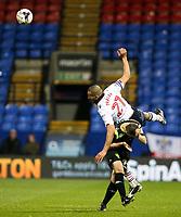 Bolton Wanderers' Darren Pratley jumps over Bury's Paul Caddis to win a header<br /> <br /> Photographer Alex Dodd/CameraSport<br /> <br /> The EFL Sky Bet League One - Bolton Wanderers v Bury - Tuesday 18th April 2017 - Macron Stadium - Bolton<br /> <br /> World Copyright &copy; 2017 CameraSport. All rights reserved. 43 Linden Ave. Countesthorpe. Leicester. England. LE8 5PG - Tel: +44 (0) 116 277 4147 - admin@camerasport.com - www.camerasport.com