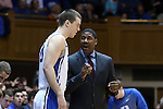08 November 2014: Duke assistant coach Nate James (right) talks to Marshall Plumlee (left). The Duke University Blue Devils hosted the University of Central Missouri Mules at Cameron Indoor Stadium in Durham, North Carolina in an NCAA Men's Basketball exhibition game. Duke won the game 87-47.