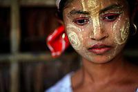 A Myanmar Rohingya girl wears traditional make-up at the village of Takebi north of the town of Sittwe May 18, 2012. REUTERS/Damir Sagolj (MYANMAR)