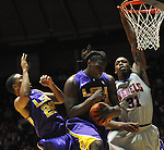 "LSU's Johnny O'Bryant III (2) grabs a rebound against LSU's Ralston Turner (22) and Mississippi's Murphy Holloway (31) at the C.M. ""Tad"" Smith Coliseum in Oxford, Miss. on Saturday, February 25, 2012. (AP Photo/Oxford Eagle, Bruce Newman).."