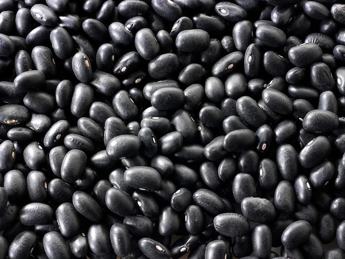 Un-cooked whole Black beans - stock photos