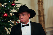 Singer Garth Brooks arrives at an event for the 2016 Kennedy Center Honorees, in the East Room of the White House, December 4, 2016. The 2016 honorees are: Argentine pianist Martha Argerich; rock band the Eagles; screen and stage actor Al Pacino; gospel and blues singer Mavis Staples; and musician James Taylor.<br /> Credit: Aude Guerrucci / Pool via CNP