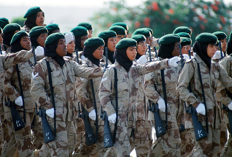 Female armed soldiers parade in camouflage uniform in Abu Dhabi for celebration of 20th Anniversary of United Arab Emirates