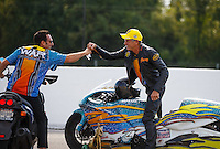 Sep 25, 2016; Madison, IL, USA; NHRA pro stock motorcycle rider Jerry Savoie celebrates with crew member after winning the Midwest Nationals at Gateway Motorsports Park. Mandatory Credit: Mark J. Rebilas-USA TODAY Sports