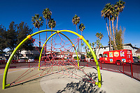A climbing rope net play structure at Circle Park, a pocket park located on Park Circle Drive in Anaheim, California.  Visible in this image is an ice cream truck.