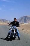 King Abdullah II of Jordan riding his motorcycle in Wadi Rum