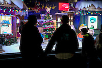 People look at a display store decorated for Christmas holidays in New York, 12/9/2015 Photo by VIEWpress