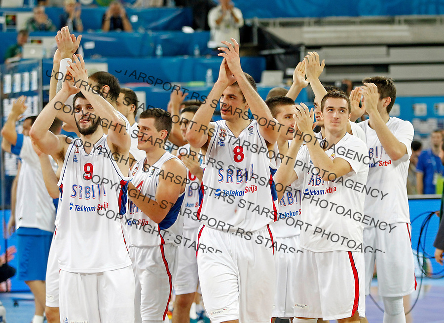 "Serbia`s national basketball team players Stefan Markovic, Nemanja Bjelica, Danilo Andjusic and Nemanja Nedovic celebrate after European basketball championship ""Eurobasket 2013""  basketball game for 7th place between Serbia and Italy in Stozice Arena in Ljubljana, Slovenia, on September 21. 2013. (credit: Pedja Milosavljevic  / thepedja@gmail.com / +381641260959)"