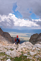 Climber descending into cloudy valley from the Lower Saddle of the Grand Teton, Grand Teton National Park, Teton County, Wyoming, USA