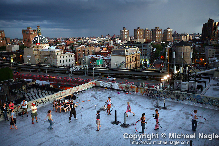 BROOKLYN - AUGUST 03, 2008:  Fire dancers rehearse on a Williamsburg rooftop, for a performance at the Burning Man festival, on August 03, 2008 in Brooklyn.  (PHOTOGRAPH BY MICHAEL NAGLE)