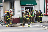 joliette firemen in full protective gear at scene of a building fire