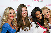 Candice Swanepoel, Chanel Iman, and Erin Heatherton pose with guest during the &quot;Incredible by Victoria's Secret&quot; launch at the Victoria Secret SOHO Store, August 10, 2010.