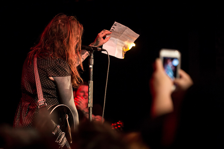 Durham, North Carolina - Sunday May 15, 2016 - Against Me! singer Laura Jane Grace burns her birth certificate at the start of their concert Sunday night at Motorco in Durham. The band kept their scheduled tour date in Durham and used the show as a platform to protest North Carolina House Bill 2.
