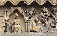 The coronation of St Honore and the discovery of the bodies of saints Fuscian, Gentian and Victoricus, from the tympanum of the South portal or St Honore portal on the South transept of the Basilique Cathedrale Notre-Dame d'Amiens or Cathedral Basilica of Our Lady of Amiens, built 1220-70 in Gothic style, Amiens, Picardy, France. St Honore or Honoratus was the 7th bishop of Amiens who lived in the 6th century AD. Amiens Cathedral was listed as a UNESCO World Heritage Site in 1981. Picture by Manuel Cohen