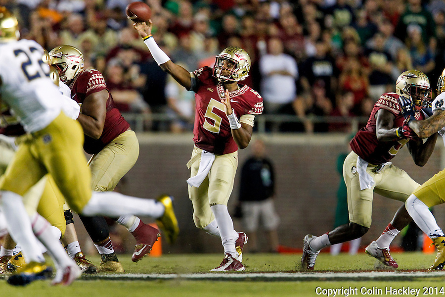 TALLAHASSEE, FLA. 10/18/14-FSU-ND101814CH-Florida State quarterback Jameis Winston throws a pass against Notre Dame's during second half action Saturday at Doak Campbell Stadium in Tallahassee. The Seminoles beat the Fighting Irish 31-27.<br /> COLIN HACKLEY PHOTO