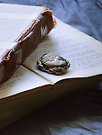An antique cameo brooch laid on a vintage book.