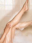 Legs of a woman taking a bath