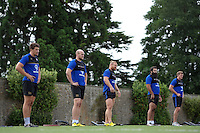 Bath Rugby forwards look on. Bath Rugby training session on August 4, 2015 at Farleigh House in Bath, England. Photo by: Patrick Khachfe / Onside Images