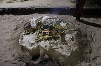 Traditional Fijian Dinner Cooked on Hot Coals in the Sand, Turtle Island, Yasawa Islands, Fiji