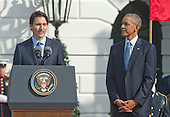 Prime Minister Justin Trudeau of Canada, left, makes remarks as United States President Barack Obama, right, listens during an Arrival Ceremony opening the Official Visit of , and Mrs. Sophie Gr&eacute;goire Trudeau on the South Lawn of the White House in Washington, DC on Thursday, March 10, 2016. <br /> Credit: Ron Sachs / CNP