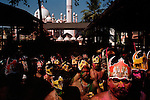 At the Sabarimala pilgrimage, Hindu pilgrims exit Vavar's mosque after a circumnavigation and head towards the shrine.