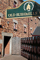 "Bushmills, Northern Ireland, United Kingdom, May 2011. The Old Bushmills Distillery is a whiskey distillery in Bushmills, County Antrim, Northern Ireland. According to the company, a distillery by this name was first recorded in 1743, although at the time it was ""in the hands of smugglers. A licence to distill in the area was granted to Sir Thomas Phillipps in 1608 by King James I, and the 1608 date is printed on the labels of the Bushmills brand whiskey. The Bushmills Distillery claims to be - and is almost unanimously considered to be - the oldest licenced distillery in the world.  For decades travellers stayed away from the sectarian violence, but since the end of'The Troubles' more and more people start discoving the beauty of Belfast and the Antrim Coast Causeway. Photo by Frits Meyst/Adventure4ever.com"