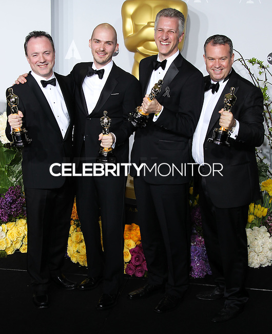 HOLLYWOOD, LOS ANGELES, CA, USA - MARCH 02: Tim Webber, Chris Lawrence, David Shirk, Neil Corbould at the 86th Annual Academy Awards - Press Room held at Dolby Theatre on March 2, 2014 in Hollywood, Los Angeles, California, United States. (Photo by Xavier Collin/Celebrity Monitor)
