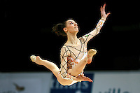 Romina Laurito of Italy split leaps to rope toss during All-Around competition at 2006 Thiais Grand Prix in Paris, France on March 25, 2006.  (Photo by Tom Theobald)