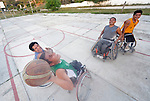Alejandro Jarquin tries to shoot the basketball while Bartolome Martinez attempts to block him during practice in Zipolite, a town in Oaxaca, Mexico. Jarquin and the other players are part of the Oaxaca Costa wheelchair basketball team.