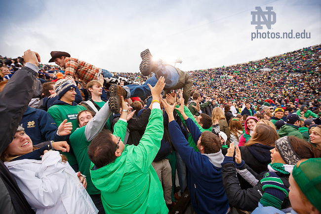 Nov. 2, 2013; Students do pushups after an Irish touchdown during the Navy game, 2013.<br /> <br /> Photo by Peter Ringenberg/University of Notre Dame