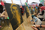 Palestinian protesters hold banners during a protest in solidarity with Palestinian prisoners on hunger strike in Israeli jails, in Gaza city on April 24, 2017. Some 1,500 Palestinian prisoners have joined the hunger strike that began earlier this week. Photo by Mohammed Asad