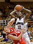 12/17/07-(Harrisonburg).JMU's Abdulai Jalloh collides with Radford's Joey Lynch-Flohr as he drives the lane during second- half action..(Pete Marovich/Daily News-Record)
