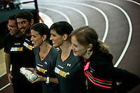 """Olympic medalist Michael Phelps (2nd L) pose for a picture next to his sisters  Whitney (C ) and Hilary (2nd R) while they attend a event called """"Official Training Restaurant of the Phelps Family"""" to support his sister Whitney as she runs the ING New York City Marathon on November 4.  the event was organized by the food company """"Subway"""" in New York, United States. 15/10/2012. Photo by VIEWpress."""