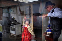 6 year old Jasmin Iancu dances with her grandfather, Ion Iancu as Marin Nicolae cooks. Buzescu is known for it's ultra-wealthy Roma and their bizarre mansions that line the main street. The Roma of Buzescu are part of the Kalderash clan and are known for being coppersmiths and dealing with metal scraps. After the fall of the communist regime in the late 80's, they stripped old factories of their metals and some made a small fortune re-selling them. They are also known for making cazane, copper stills that produce alcohol such as palinka, a plum brandy.