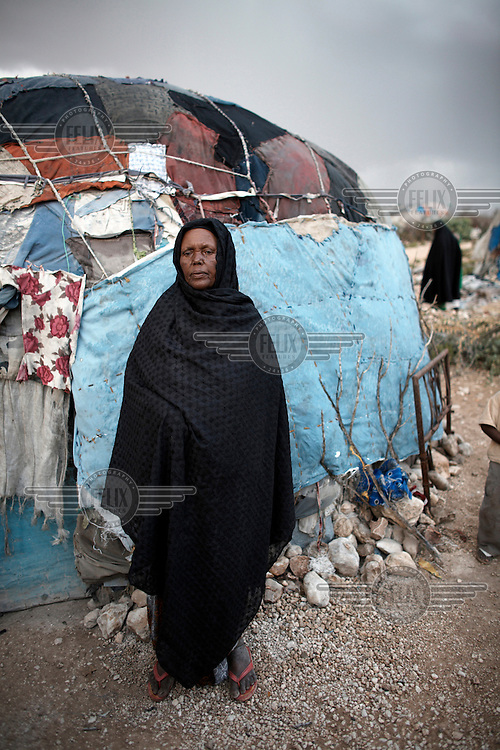 A woman stands outside her home in the Kililka Shanad camp for displaced persons on the outskirts of Hargeisa. Thousands fled to Ethiopia during the civil war in 1988 and returned in 1991 to find they no longer had homes.