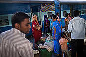 Travellers arrive at the platform of the busy New Delhi Railway Station in New Delhi, India. Photo: Sanjit Das/Panos