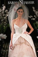 Model walks runway in a Romance wedding dress by Sarah Jassir, for the Sarah Jassir Fall 2011 - Desire bridal collection.