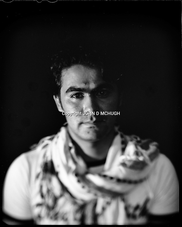 "Noorullah Noory, a young Afghan businessman, is seen in his internet cafe in Kabul, 28 August 2012. This portrait was shot on a 5x4 Linhof Technika IV, circa 1959, and a Schneider Kreuznach 270mm lens, circa 1952, with front tilt, and is part of a series entitled ""Putting an Afghan face on the war."" (John D McHugh)"
