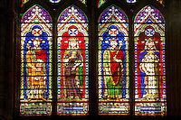 Medieval Gothic stained glass window showing, Left King Henry and his wife and King Philippe and his wife The Gothic Cathedral Basilica of Saint Denis ( Basilique Saint-Denis ) Paris, France. A UNESCO World Heritage Site.
