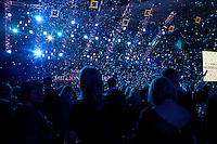 Moscow, Russia, 23/10/2009..Ticker tape falls on guests at the opening of the Millionaire Fair in Moscow. The event has become an annual fixture, attracting thousands of would-be and existing Russian millionaires to view and purchase a wide range of luxury goods. This year however the fair was much smaller, an indication of how the formerly booming Russian economy has been hit by the world financial crisis.