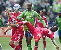 Chicago Fire forward Patrick Nyarko kicks the ball away from Seattle Sounders FC forward Steve Zakuani during play at Qwest Field in Seattle Tuesday April 8, 2011. The Sounders won the game 2-1. At left is \Chicago Fire midfielder Logan Pause.