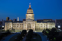 New Texas State Capitol Building and UT Tower at twilight, government home in Austin, Texas and Office of the Governor, Rick Perry.