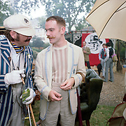 """Chaps - Retro socializing in London. 2009. The Chap Olympiad 2009. The Chap Olympiad is an annual event held in central London by the Chap magazine, it allows assorted retro socialisers a place to gather for a day. """"Atters"""" the official Mascot of the Chap magazine, is conversing with fellow chap Will."""