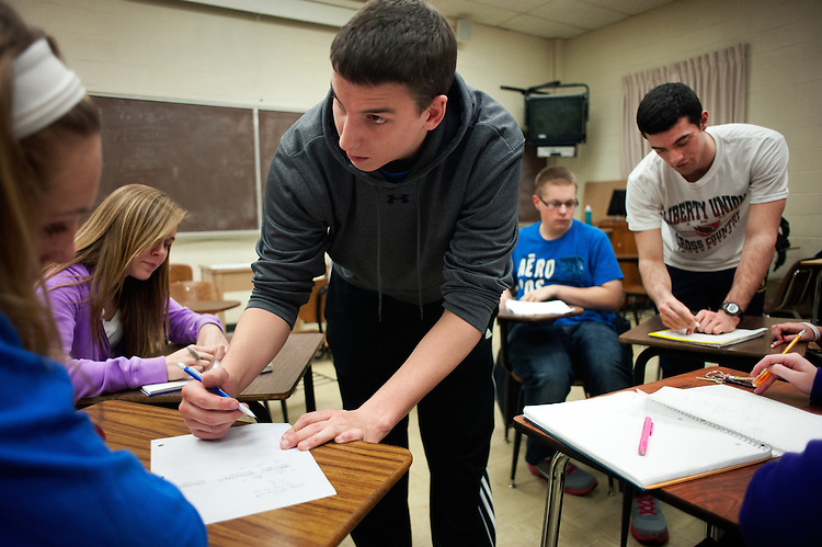 Supplemental instruction leaders Kevin McCormick (center) and Connor Cox (far right) assist Bailey Hanson (left), Brooke Aleshire (second from left) and Caleb Greenwood (second from right) with an equation during a supplemental instruction session in Morton Hall. Photo by: Ross Brinkerhoff.