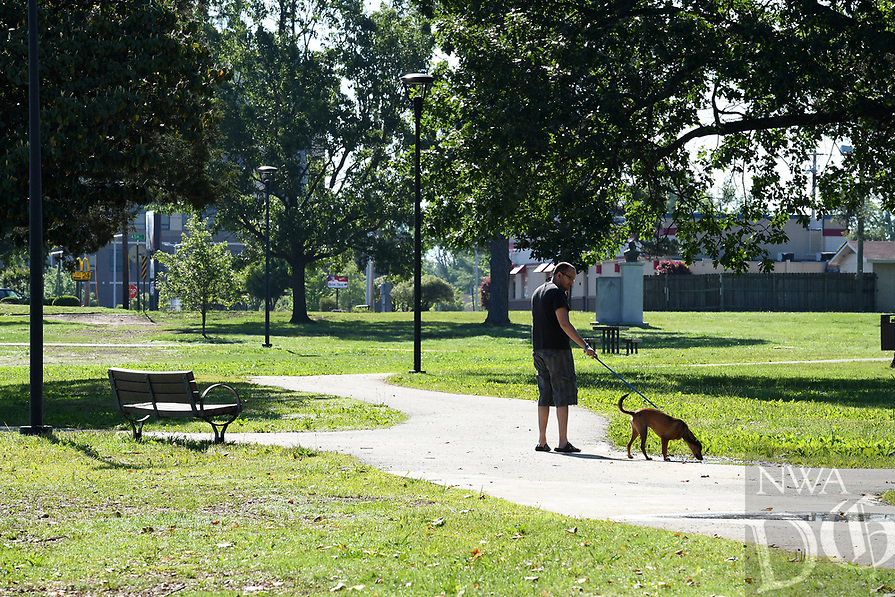NWA Democrat-Gazette/J.T. WAMPLER Blair Smith of Springdale, walks his dog Bubba May 13, 2017 at Murphy Park in Springdale. Smith comes to the park several times a week to walk Bubba. The city will hold Murphy in May on Friday, May 19 to celebrate renovations to the park.